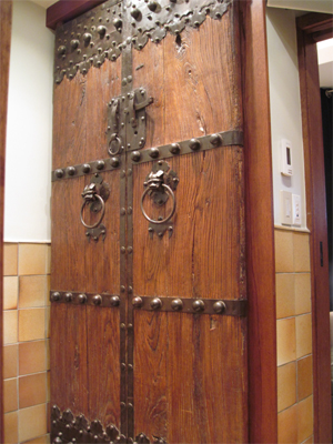 Antique doors from Asia on the linen closet.