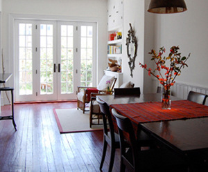The dining room, looking into the kitchen.