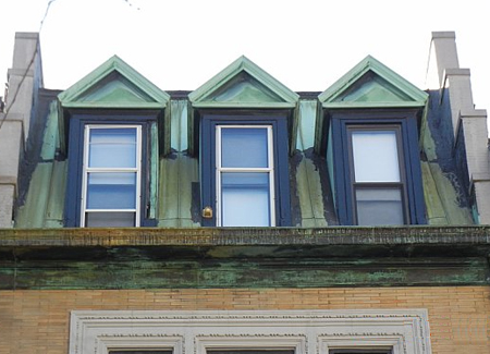 Copper dormers on row house number 244.
