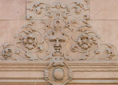 Architectural detail over the parlor floor window of row house number 248.
