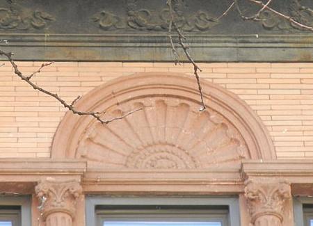 Highly decorative stonework on a row house facade on West 71st Street.