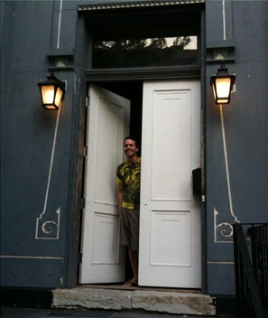 The owner with his row house.