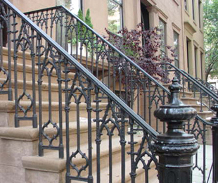 Ornate iron railings on a brownstone in Cobble Hill, Brooklyn.