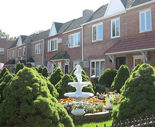 A front yard fountain in Middle Village, New York.