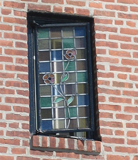 A window detail on a Row House in Middle Village, NY.