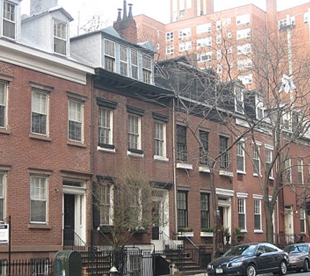 These five homes, located on Van Dam Street, are rare examples of Federal row house with the dormers still intact.