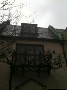 It was a rainy day so the picture is a little dark. Each row house is unique. This one has a charming balcony.