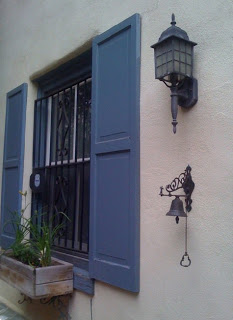 Row house with blue trim and iron details.