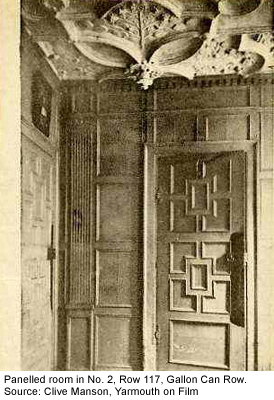 A paneled room inside one of the older homes.