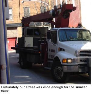 Crane installation of our HVAC unit.