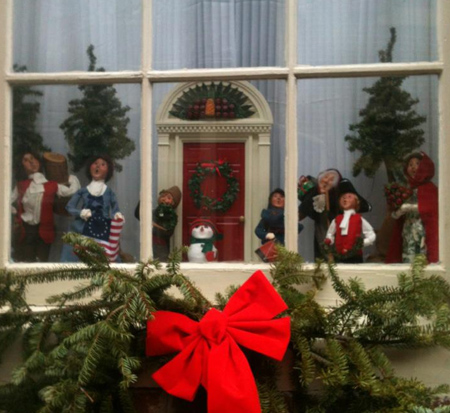 A very happy holiday row house window!