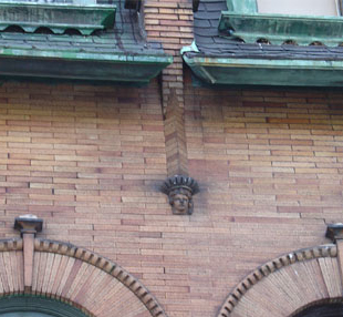 Small statuary and copper gutters on a Victorian home in West Philadelphia.