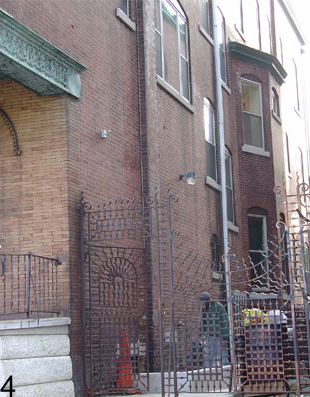 Orante iron gates, a Victorian home in West Philadelphia.