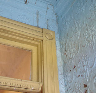 The developer is saving as much of the original materials as possible such as the stamped tin panels in the entry way.