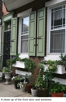 The front door and windows of their row house.