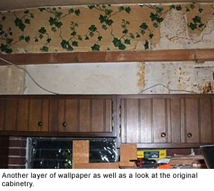 Another layer of wallpaper and the original cabinets.