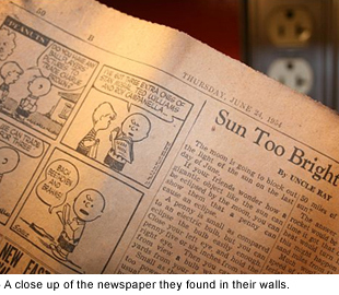 A close-up of the newspaper they found in their walls.