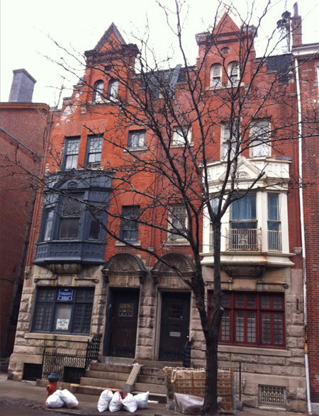 Here is a full shot of the front of two Dutch Revival row houses. Notice the stepped roof line.