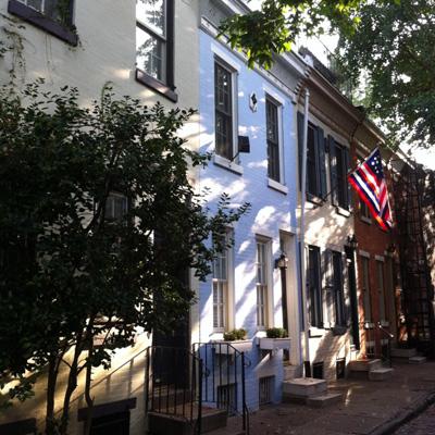 Beautiful blue row house on a small street in Philadelphia.